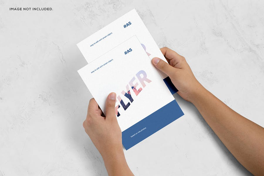 Flyer in Hand Mockup PSD