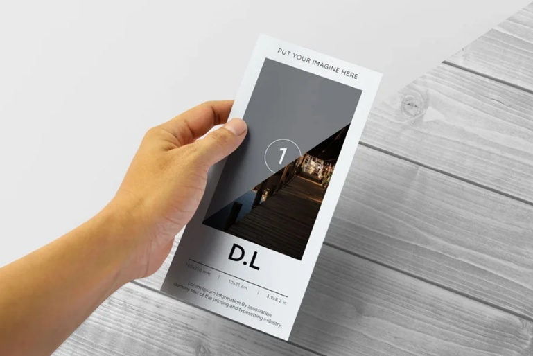 DL Flyers in Hand Mockup PSD