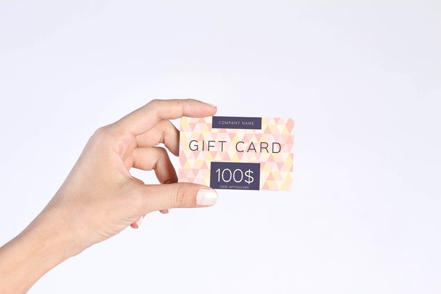 Gift Card in Hand Mockup PSD